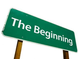 the-beginning-road-sign